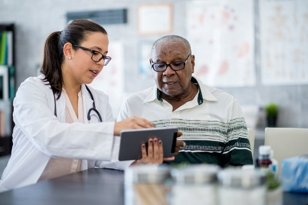 Making Genomics the Standard of Care in Community Cancer Centers